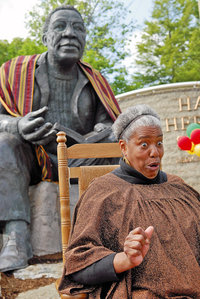 "From goKnoxville: ""Linda Upton Hill tells stories to a group of children at the 10-year anniversary of the dedication of Haley Heritage Square in this 2008 file photo."""